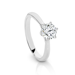 Our Signature Solitaire engagement ring set with a single 0.70ct Diamond.  18ct White Gold.