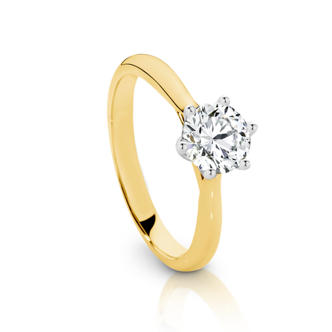 Our Signature Solitaire engagement ring set with a single 0.70ct Diamond.  18ct Yellow Gold.