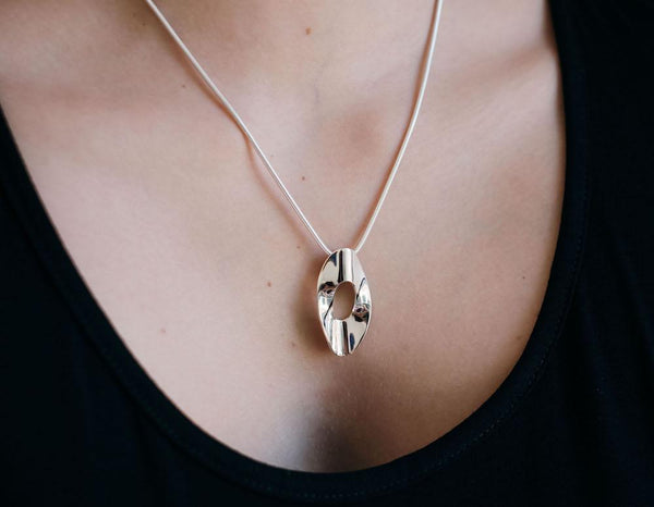 handmade sterling silver pendant worn by model