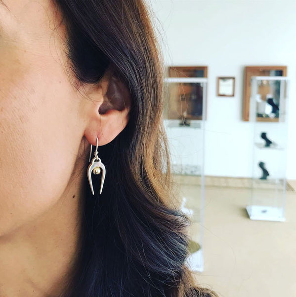 Amy wearing Black Matter Penumbra Earrings in silver and gold