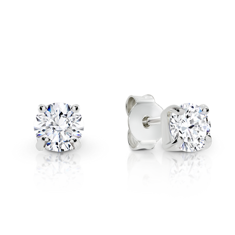 Signature Solitaire Diamond Stud Earrings, set in White Gold.