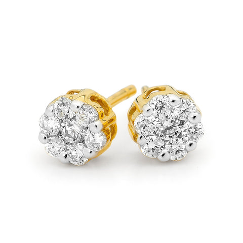 a cluster of diamonds, set in yellow gold on a stud earring fitting