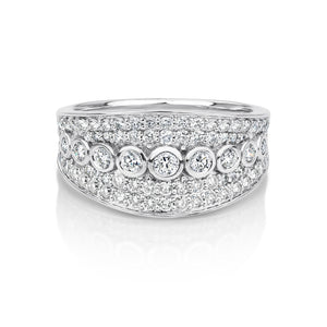 Wide white gold dress ring set with diamonds