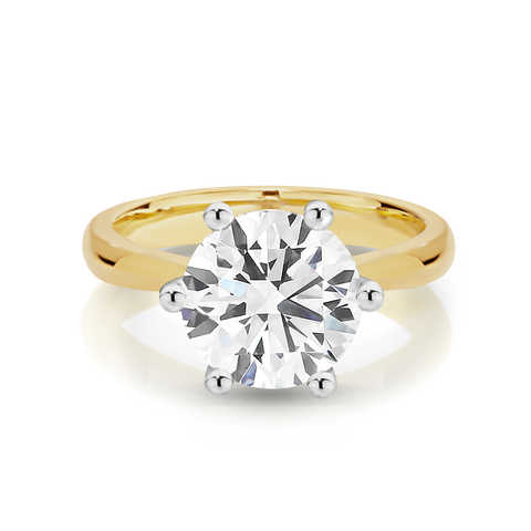 Our Signature Solitaire engagement ring set with a single 1.50ct Diamond.  18ct Yellow Gold.