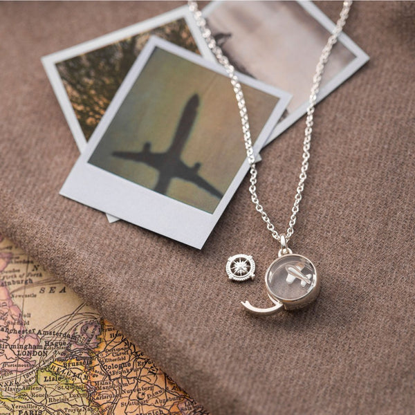 Locket with charms for travelling