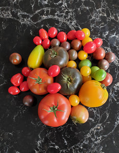 One kg large heirlooms and 2 punnets (500g) of cherry toms