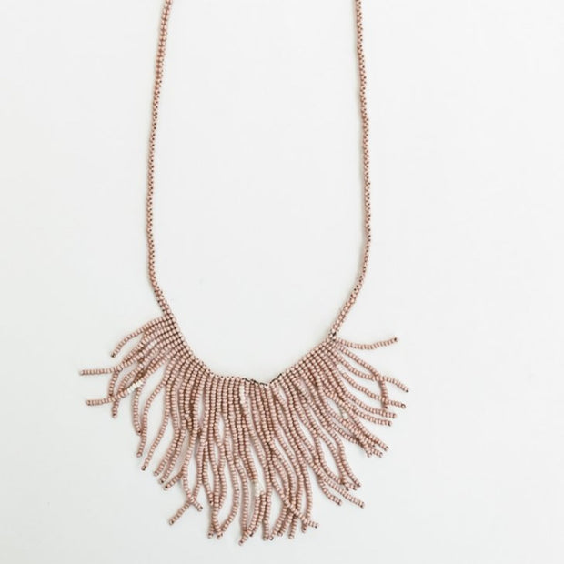 Handmade beaded blush fringe necklace made by Artisans in Haiti from eduacational programs providing fair wages and self-independence through generational change