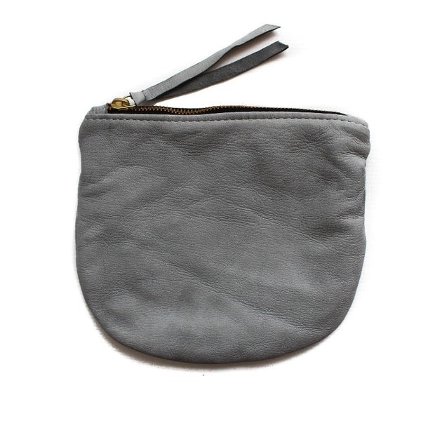Soft leather grey pouch 8x6 made by artisans in Haiti through educational programs that provide fair wages and self-independence with generational change