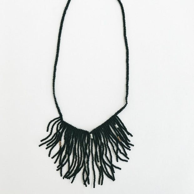 Handmade beaded black fringe necklace made by Artisans in Haiti from eduacational programs providing fair wages and self-independence through generational change