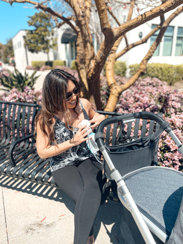 breastfeeding mom pumping mom on the go with uppababy vista stroller