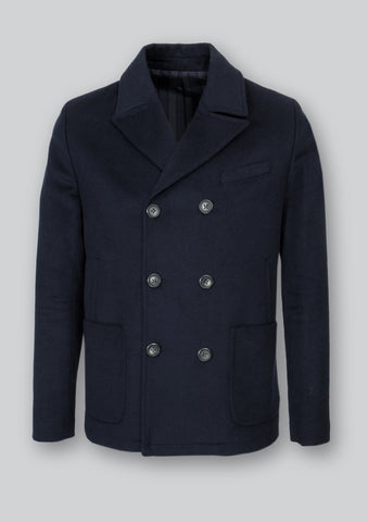 Men's hip length, double breasted navy coat in Italian wool fabric. Front patch pockets and full lining