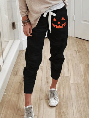 Ladies Orange Pumpkin Head Pattern Black Camouflage Print Trousers