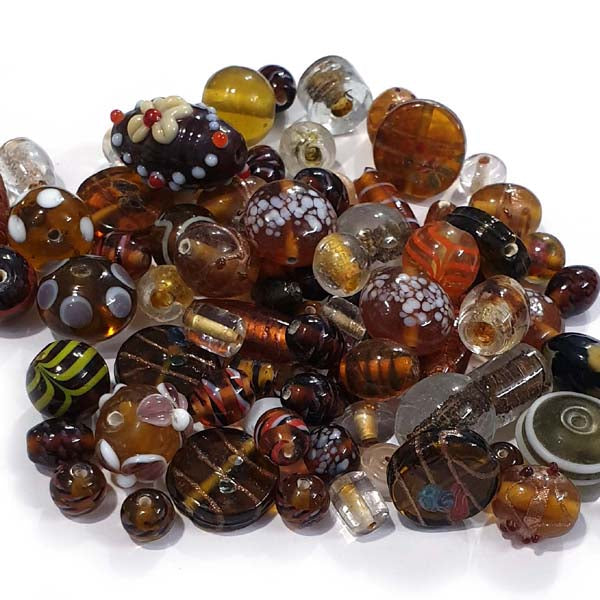 Brown fancy mixed glass beads,  sold by Per Pkg. 250 Gram. Size about 10mm to 16mm,