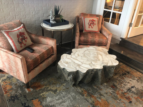Sitting area with two arm chairs, coffee table, and end table.