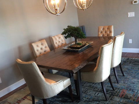dining room scene with large rectangular dining table and chairs.