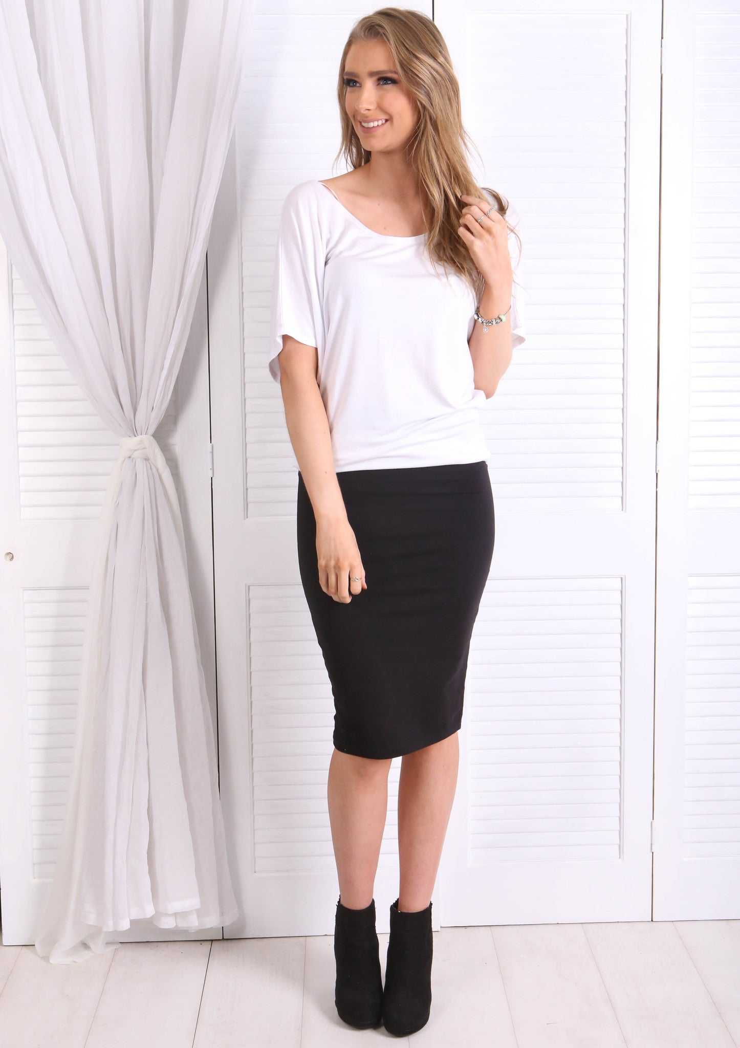 THE MIDI SKIRT BLACK - BASICS