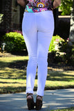 Rear view of woman wearing ripped white skinny jeans