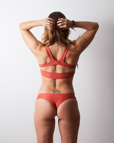 terracotta red wide sides seamless cheeky surf bikini bottom