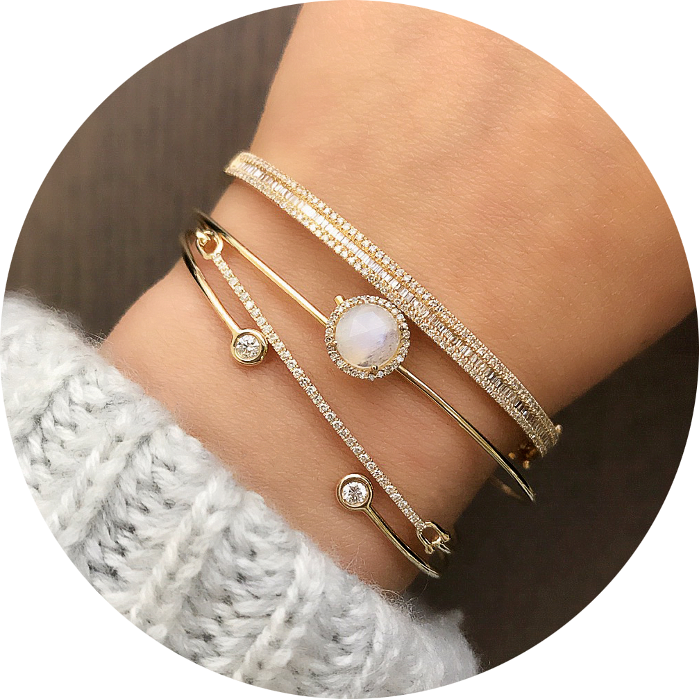 selection of bangles layered with the rainbow moonstone rosie hook bangle