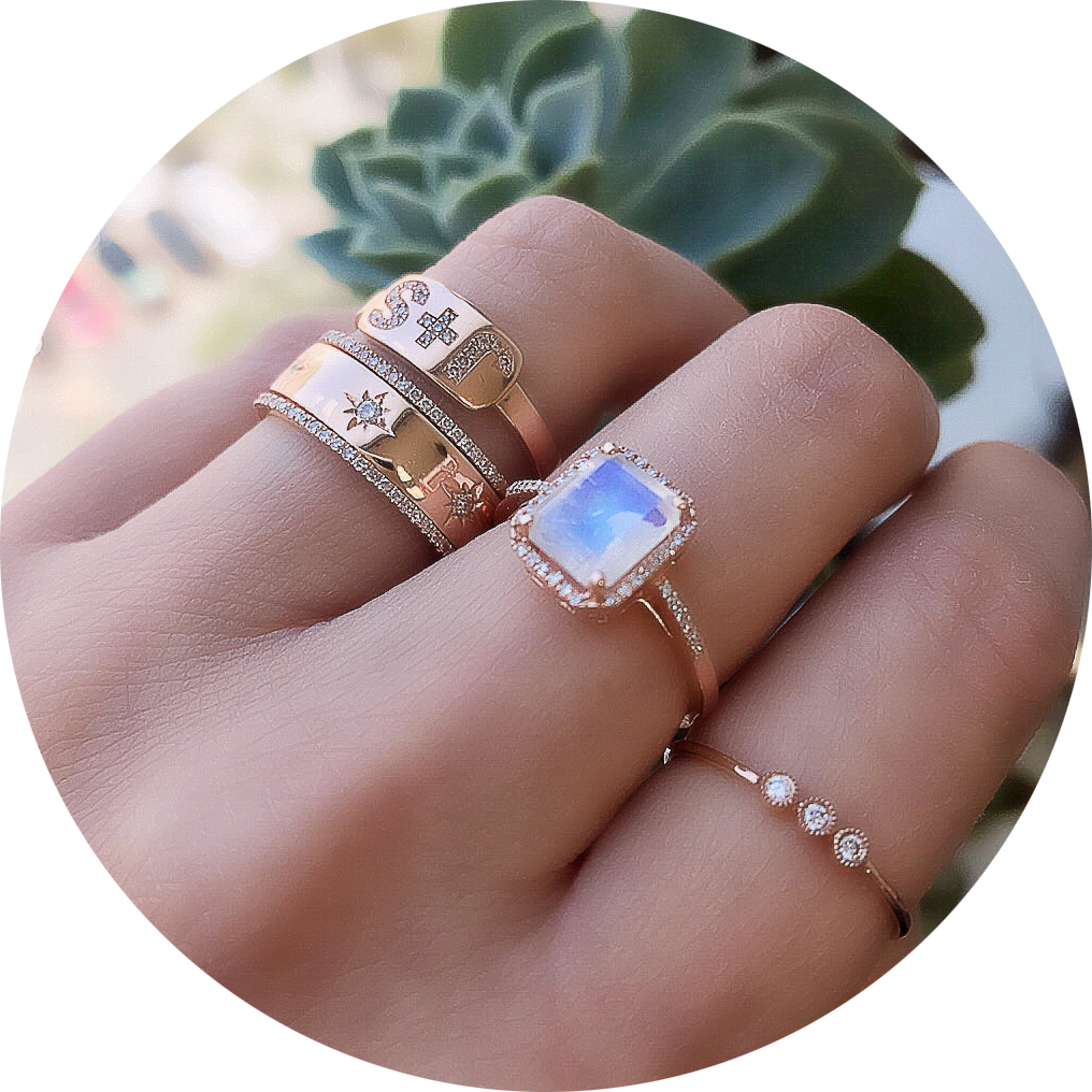 rainbow moonstone ring shown with other liven rings