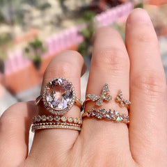 beautiful soft pink morganite rings, layered with rose gold and diamond rings