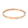 14k rose gold high polish bangle with diamonds