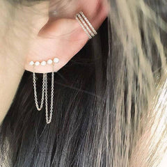 Triple row ear cuff shown on ear