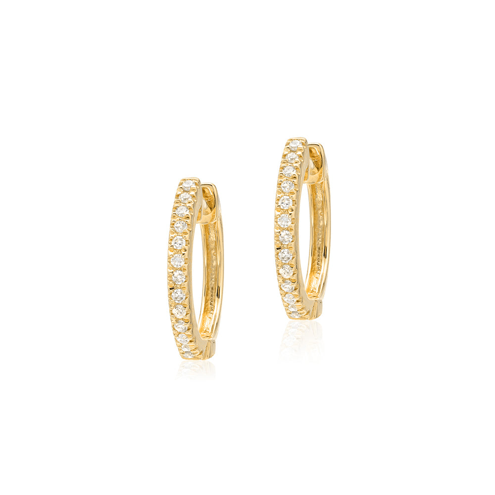 small diamond huggies in yellow gold