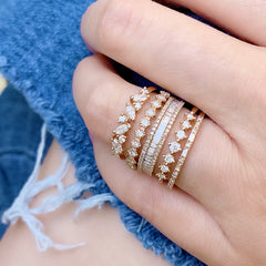 baguette and diamond halfway band stacked with other liven rings
