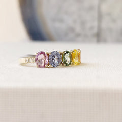 band set with 6 oval colored sapphires in 14k gold with accent diamonds