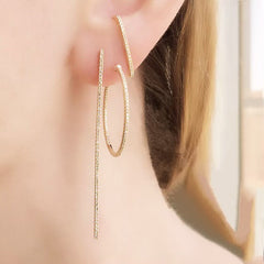 classic 25mm hoops worn with our lobe cuff post and long stick diamond earring for a cool modern look