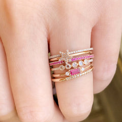 ruby baguette band stacked with other rings