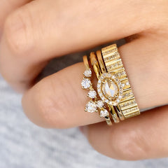 marquise ring nested with other stackable liven bands