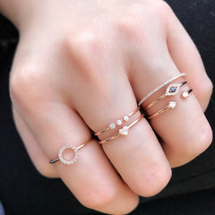 petite heart stackable band worn with other liven rings