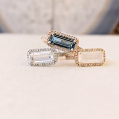 east-west emerald cut colored stone rings
