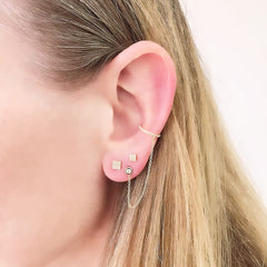 a layered ear look with an illusion cuff