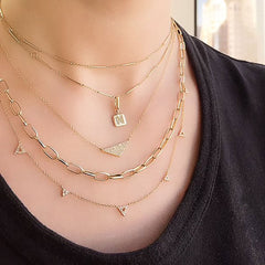 medium pave triangle necklace worn with other necklaces