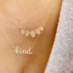 five pear shape necklace with pave diamonds layered with other liven necklaces