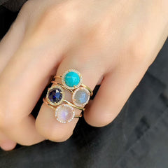 a selection of rosie rings in varous colored stones