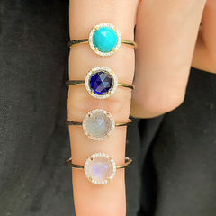 a selection of rosie rings in various colored stones
