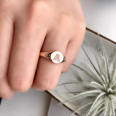 "initial signet ring in ""A"" in 14k rose gold on hand"
