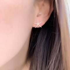 Starfish earrings on ear