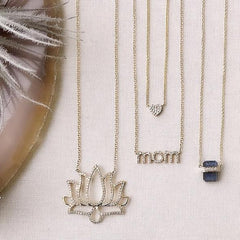 ethos necklace shown with other liven pieces