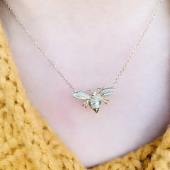 larger bee necklace on neck