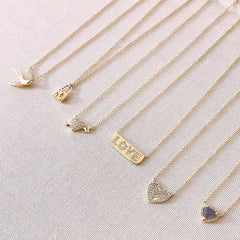 a selection of romantic necklaces