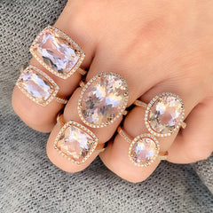 selection of morganite rings set in 14k gold with diamonds