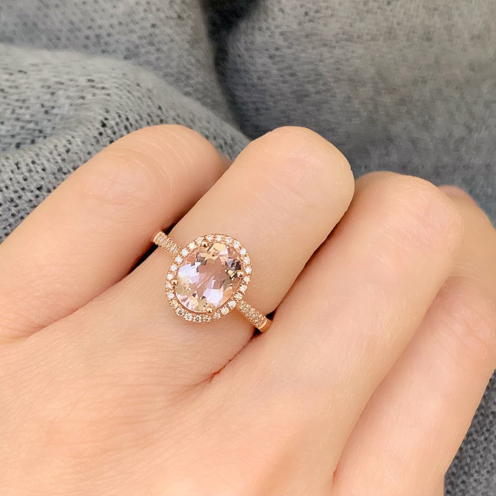 Small oval morganite ring set in 14k rose gold with diamonds