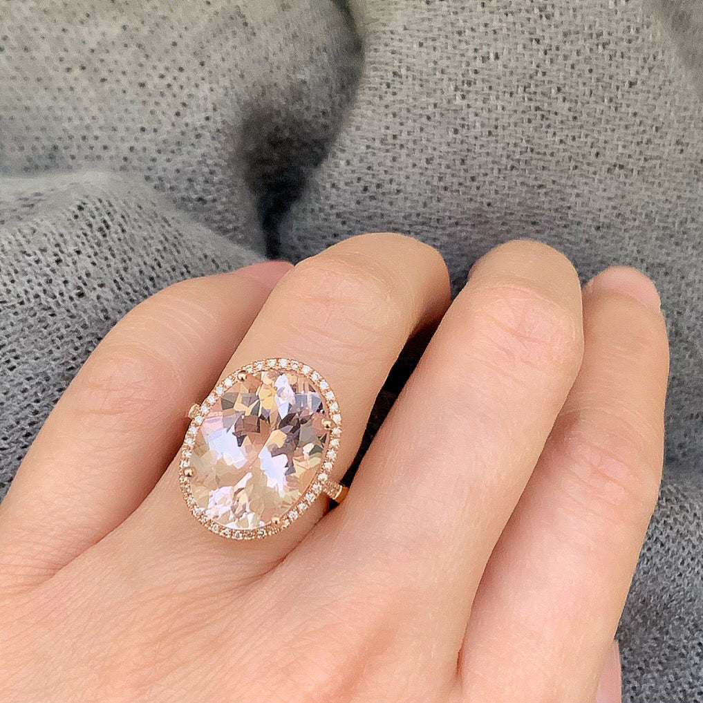 large oval morganite set in 14k gold with diamonds