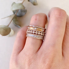 heirloom baguette diamond halfway band stacked with other liven rings