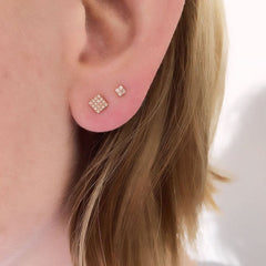 square post earring on ear
